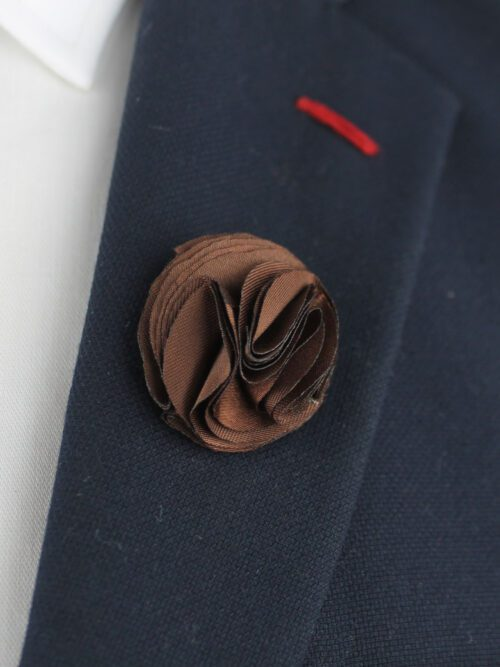 Brown lapel pin flower